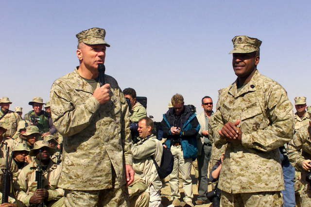 US Marine Corps (USMC) personnel with the 5th Marine Regiment, 1ST Marine Division from Camp Pendleton, California, listen to the Commandant of the Marine Corps (MCM) General (GEN) Michael W. Hagee and Sergeant Major of the Marine Corps (SMMC) Alford L. McMichael at Camp Coyote in northern Kuwait (KWT) while in support of Operation ENDURING FREEDOM