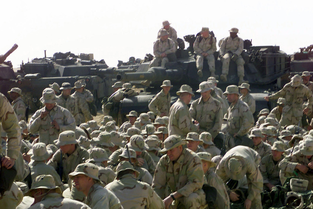 US Marines from Task Force Five gather at Camp Coyote, a Forward Area Supply Point (FASP), during Operation ENDURING FREEDOM. (Substandard image)
