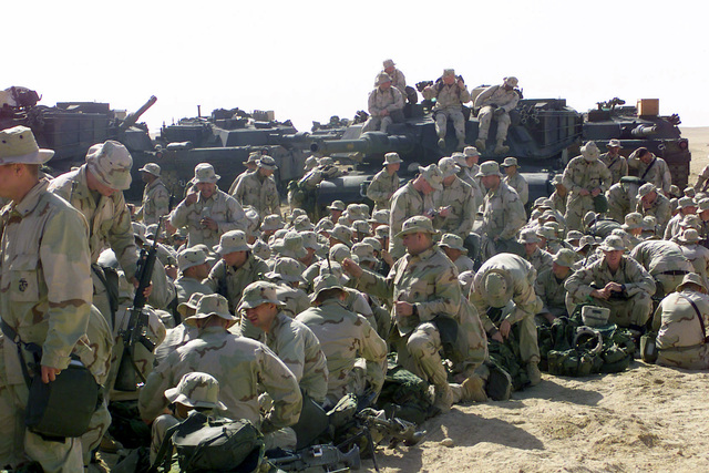 US Marines from Task Force Five gather at Camp Coyote, a Forward Area Supply Point (FASP), during Operation ENDURING FREEDOM