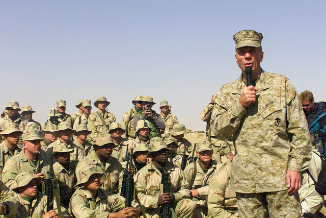 US Marines from the 5th Marine Regiment, 1ST Marine Division, Camp Pendleton, California, Headquarters, gather at Camp Coyote, northern Kuwait and listen General (GEN) Michael W. Hagee, Commandant of the Marine Corps, during Operation ENDURING FREEDOM