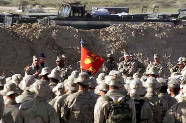 On his visit to Amhad Al Jabar Air base, Kuwait, the Commandant of the US Marine Corps (CUSMC), General (GEN) Michael W. Hagee, speaks to more than 400 Marines, during Operation ENDURING FREEDOM