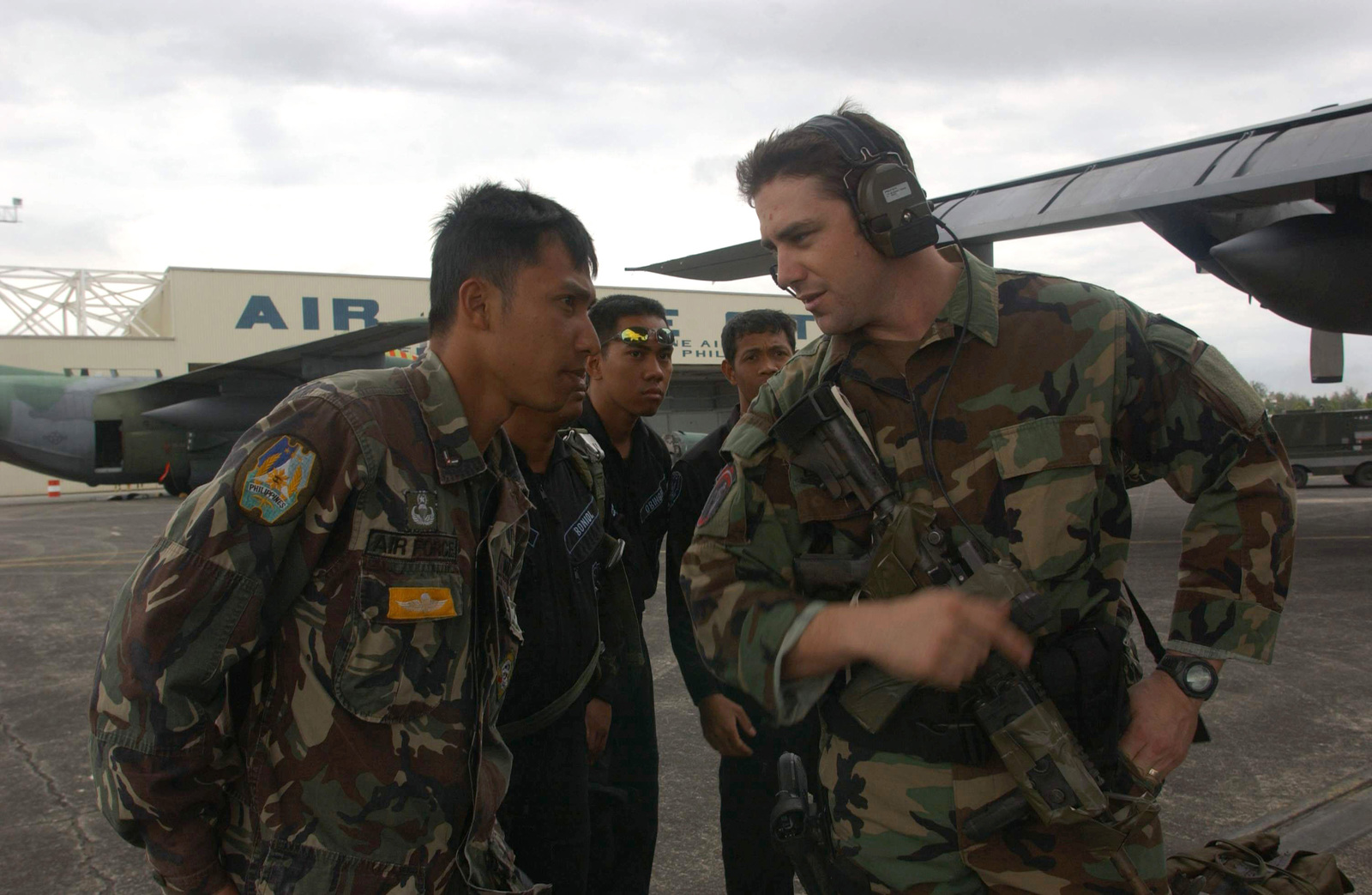 US Air Force (USAF) STAFF Sergeant (SSGT) Michael Paulson (right), Combat Controller, 320th Special Tactics Squadron (STS), Kadena Air Base (AB), Japan, briefs Philippine Air Force (PAF) AIRMAN First Class (A1C) Joseph Delacruz on exercise procedures during a joint training session during BALANCE PISTON 03-5. The joint exercise is designed to improve the interoperability and tactical proficiency of the armed forces of the US and Philippines