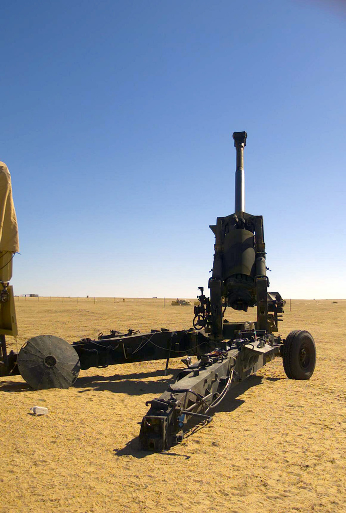 A US Marine Corps (USMC) 155mm Howitzer M198 assigned to T/Battery, 5/11 7th Marines, at Camp Coyote, Kuwait, during Operation ENDURING FREEDOM