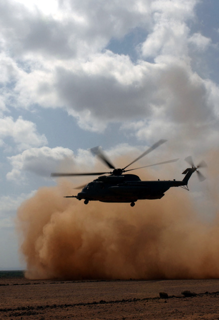 US Air Force (USAF) Airmen of the Air Force Special Operations (AFSO) Detachment, Camp Lemonier, Djibouti, conduct dust-out (landing in zero visibility dust storm) training onboard a USAF MH-53M Pave Low IV during Operation ENDURING FREEDOM