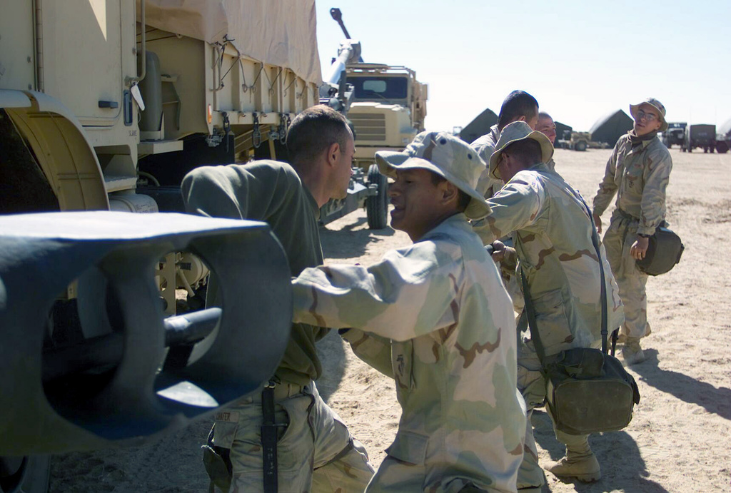 US Marine Corps (USMC) Marines assigned to T/Battery, 5/11 7th Marines, service their 155mm Howitzer M198, at Camp Coyote, Kuwait, during Operation ENDURING FREEDOM