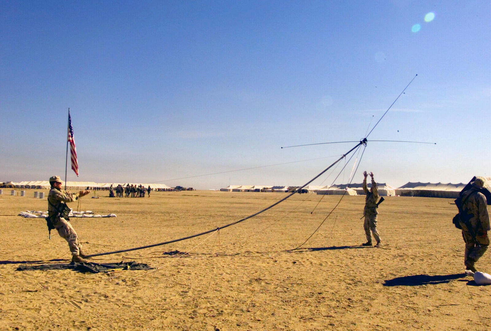 US Marine Corps (USMC) Marines raise a High Frequency (HF
