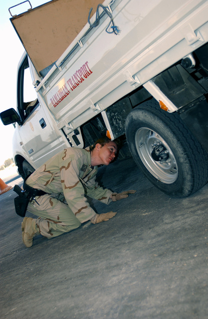 US Air Force (USAF) STAFF Sergeant (SSGT) Laura Palmer, 384th Expeditionary Security Forces Squadron (ESFS), searches all vehicles for contraband and weapons in the search pit at the 384th Air Expeditionary Wing (AEW) forward deployed location