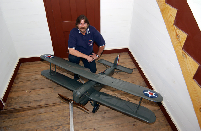 "Art Rigg, brother of museum curator Harold D. ""Buck"" Rigg, poses by the 1/6th scale model of a Douglas O-6 Observation aircraft he built and donated to the Eighth Air Force Museum, Barksdale Air Force Base (AFB), Louisiana (LA), in memory of their father, Lieutenant Colonel (LCOL) H.M. ""Hal"" Rigg. This is the type of aircraft that Lieutenant (LT) Eugene Hoy Barksdale, namesake of Barksdale AFB, flew on Aug 11, 1926 over McCook Field, Dayton Ohio (OH) testing the airplane for spin characteristics, and attempted to bailout when he could not recover from a flat spin. His parachute became entangled in the wing's brace wires and fell to his death. Barksdale AFB celebrated its 70th..."