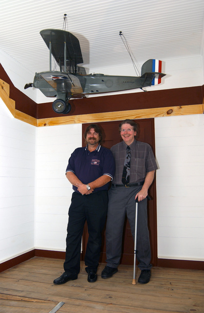 "Museum curator Harold D. ""Buck"" Rigg (right) and his brother Art Rigg, who built the 1/6th scale model of a Douglas O-6 Observation aircraft and donated it to the Eighth Air Force Museum, Barksdale Air Force Base (AFB), Louisiana (LA), in memory of their father, Lieutenant Colonel (LCOL) H.M. ""Hal"" Rigg. This is the type of aircraft that Lieutenant (LT) Eugene Hoy Barksdale, namesake of Barksdale AFB, flew on Aug 11, 1926 over McCook Field, Dayton Ohio (OH) testing the airplane for spin characteristics, and attempted to bailout when he could not recover from a flat spin. His parachute became entangled in the wing's brace wires and fell to his death. Barksdale AFB celebrated its 70th..."
