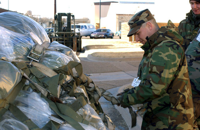 US Air Force (USAF) AIRMAN First Class, (A1C), Angelo Palermo, 27th Equipment Maintenance Squadron, secures cargo pallet straps as part of a base wide Operational Readiness Inspection (ORI) exercise at Cannon Air Force Base (AFB), New Mexico (NM)