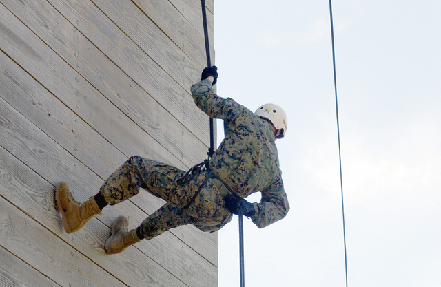 Sergeant (SGT) Patrick J. Ezel from the Weapons Field Training Battalion (WFTB), Field Training Company (FTC), Field Training Platoon (FTP), repels off the Parris Island Rappel Tower at Page Field, at Marine Corps Recruiting Depot (MCRD), Parris Island, South Carolina