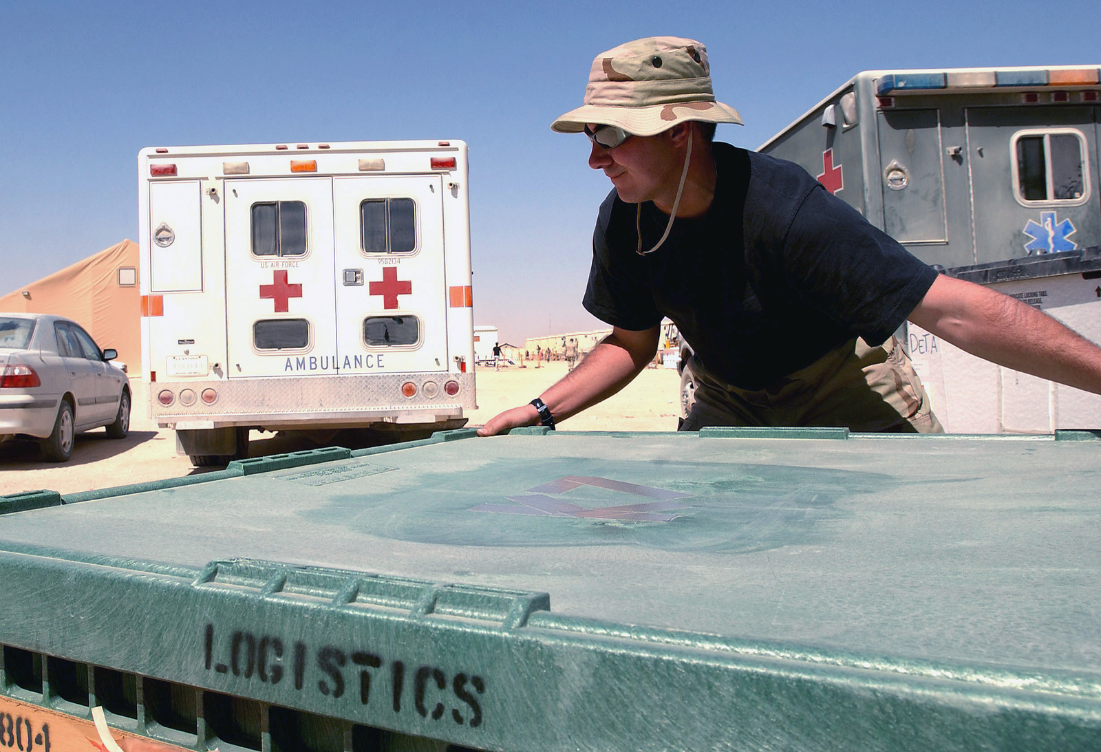 A US Air Force (USAF) Airmen assigned to the 405th Expeditionary Medical Squadron (EMS), prepares to unpack supplies after arriving at a forward deployed location, during Operation ENDURING FREEDOM