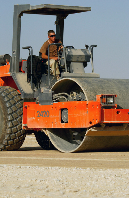 A US Air Force (USAF) Heavy Equipment Operator assigned to the 823rd Red Horse Squadron (RHS), operated a self-propelled vibratory roller during a taxiway and support ramp construction project at a forward deployed location during Operation ENDURING FREEDOM