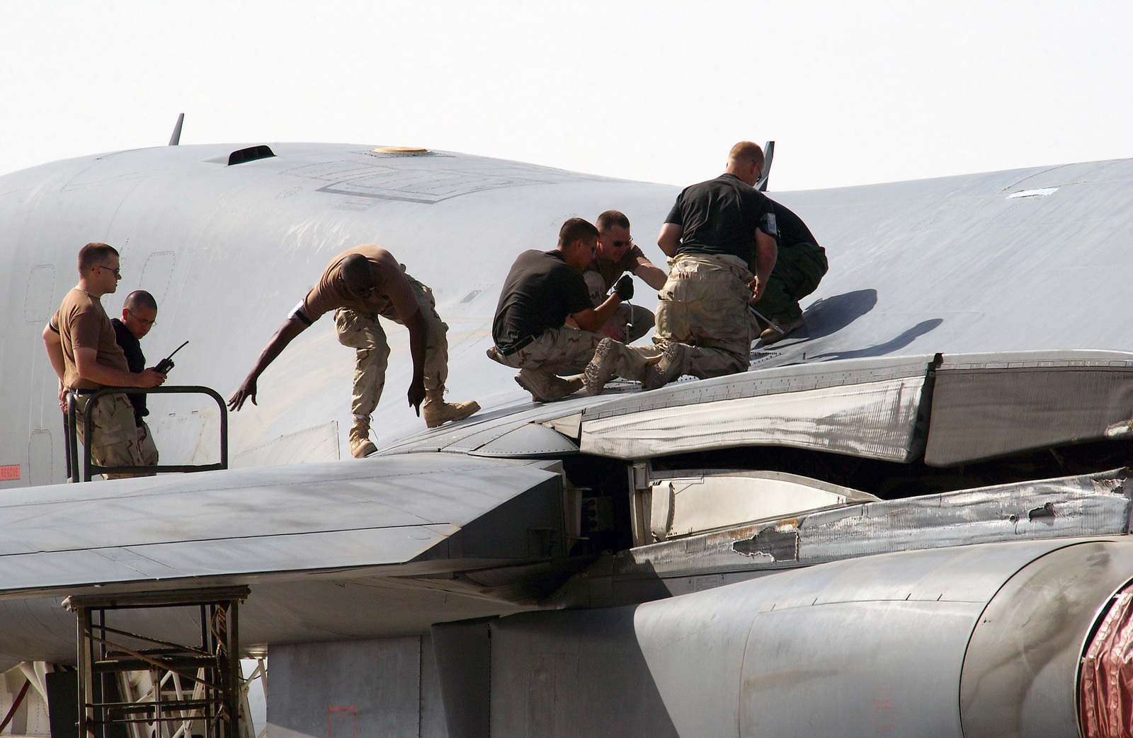 US Air Force (USAF) Airmen assigned to the 28th Expeditionary Aircraft Maintenance Squadron (EAMS), perform maintenance on a USAF B-1B Lancer aircraft at an undisclosed forward deployed location during Operation ENDURING FREEDOM