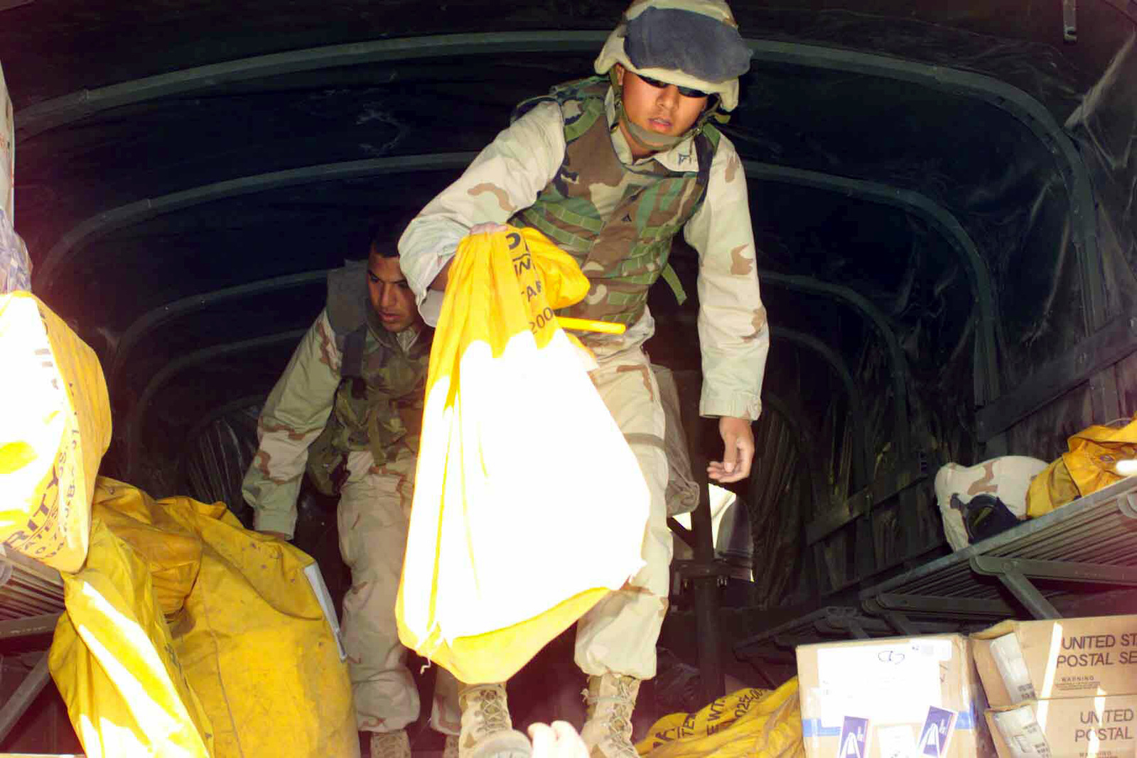US Marine Corps (USMC) Postal Clerks from the 7th Marine Regiment, separate incoming mail by Battalion at Camp Coyote, Kuwait, during Operation ENDURING FREEDOM