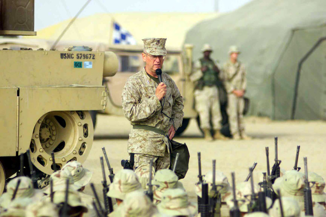 Holding their Colt 5.56mm M16A2 Assault Rifles, US Marine Corps (USMC) personnel from the 7th Marine Regiment, enjoy a question and answer session with Major General (MGEN) James N. Mattis, Commanding General (CG) of the 1ST Marine Division, during Operation ENDURING FREEDOM