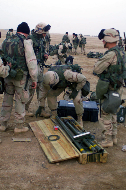 US Marine Corps (USMC) personnel with Bravo Company, 1ST Combat Engineer Battalion (CEB), 1ST Marine Division out of Camp Pendleton, California, break open an M1A1 Bangalore Torpedo mine and fence clearing kit on Camp Coyote, Kuwait (KWT), during Operation ENDURING FREEDOM