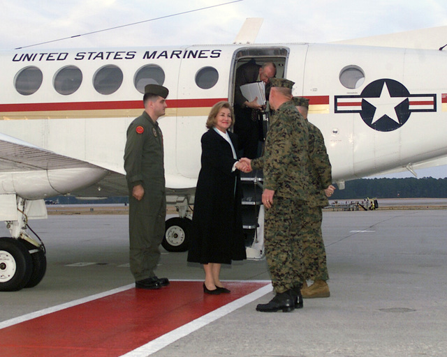 US Senator The Honorable Elizabeth Dole (R-NC) (center) is greeted by US Marine Corps (USMC) Major General (MGEN) John G. Castellaw (foreground right), Commanding General, 2nd Marine Air Wing (MAW) and USMC MGEN Robert M. Flannagan, Commanding General, Marine Corps Air Bases East; after arriving aboard a USMC UC-12B Huron aircraft at Marine Corps Air Station (MCAS) Cherry Point, North Carolina (NC). (SUBSTANDARD)