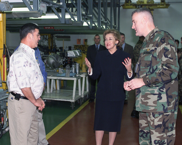 US Senator The Honorable Elizabeth Dole (R-NC) (center), talks with employees at the Naval Aviation Depot (NADEP), during her visit at Marine Corps Air Station (MCAS) Cherry Point, North Carolina (NC). US Marine Corps (USMC) Colonel (COL) Conti, is pictured right