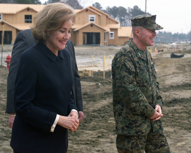 US Senator The Honorable Elizabeth Dole (R-NC) (foreground), is given a tour of the new military housing being constructed for the ranks of E-5 through E-1, by US Marine Corps (USMC) Major General (MGEN) Robert M. Flannagan, Commanding General, Marine Corps Air Bases, during her visit at Marine Corps Air Station (MCAS) Cherry Point, North Carolina (NC)