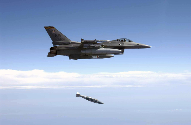 An US Air Force (USAF) F-16C Fighting Falcon from the 78th Fighter Squadron (FS), Shaw Air Force Base (AFB), South Carolina, releases a GBU-31 2,000 pound Joint Direct Attack Munition (JDAM) over the Eglin AFB, Land Range during a test mission