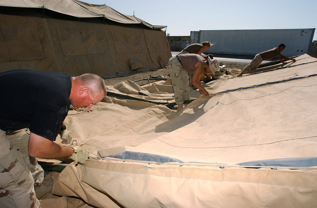 US Air Force (USAF) members of the 321st Air Expeditionary Wing (AEW) prepare temper tents at a forward-deployed location in support of Operation ENDURING ... & US Air Force (USAF) members of the 321st Air Expeditionary Wing ...