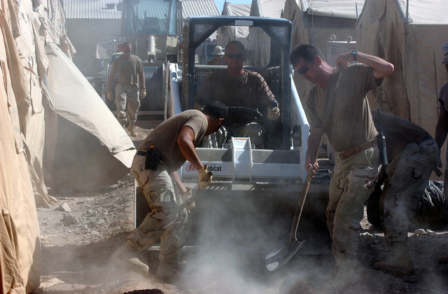 US Air Force (USAF) members of the 321st Expeditionary Civil Engineering Squadron (CES), bury power cables at a forward-deployed location, in support of Operation ENDURING FREEDOM