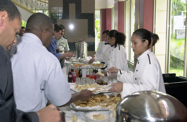 US Southern Command (USSOUTHCOM) sponsored participants from Central America, the Caribbean and the US Army South (USARSO) enjoy a coffee break following a seminar at the Inter-Continental Hotel Convention Center in Managua, Nicaragua, during Exercise Fuerzas Aliadas Humanitarian 2003 (FA- HUM 03). The Exercise design is to continue the development of regional disaster management plans and to improve the direct integration and cooperation among the nations and agencies involved