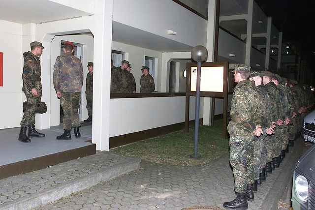 A Deutschland / Germany (DEU) Bundeswehr Soldiers wait to process into a Spangdahlem Air Base (AB) barracks, during their assignment to augment the 52nd Security Forces Squadron (SFS), and help to provide base security