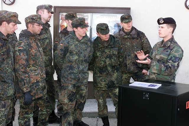 At Spangdahlem Air Base (AB), Deutschland / Germany (DEU) Bundeswehr Soldiers receive training from US Air Force (USAF) STAFF Sergeant (SSGT) Paul Kilquist, in the use of the Under Vehicle Surveillance System, so they can help provide base security