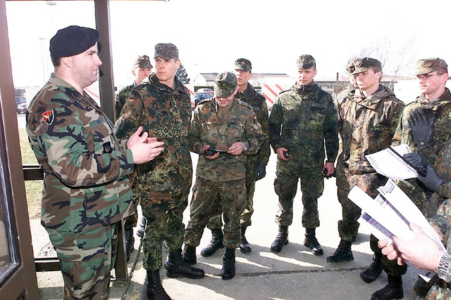 At Spangdahlem Air Base (AB), Deutschland / Germany (DEU) Bundeswehr Soldiers receive training from US Air Force (USAF) training instructor Frankie Hau, on security operations, so they can help provide base security