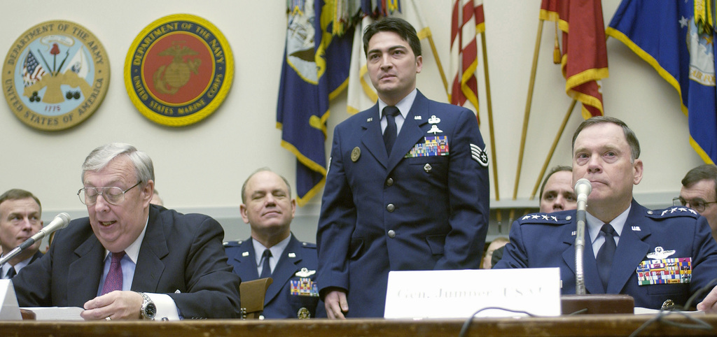 Secretary of the Air Force (SECAF), The Honorable Dr. James G. Roche, (left) introduces US Air Force (USAF) STAFF Sergeant (SSGT) Alan T. Yoshida (standing) to members of the House Armed Services Committee, during the fiscal year 2004 Air Force budget request on Capitol Hill, Washington, District of Columbia. SSGT Yoshida, a Combat Control Craftsman with the Air Force Special Operations Command, was wounded in Afghanistan, and was named one of the 12 outstanding Air Force Airmen in 2002. Seated foreground right is USAF General (GEN) John P. Jumper, Air Force CHIEF of STAFF