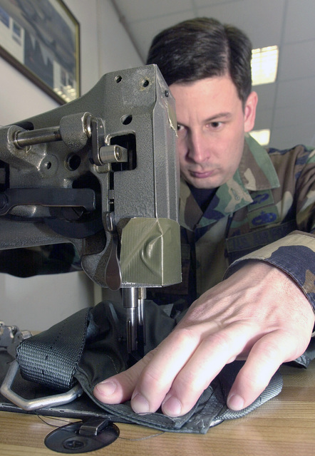 US Air Force (USAF) STAFF Sergeant (SSGT) Daniel Lewis, Survival Equipment Journeyman, 31st Maintenance Squadron (MXS), modifies a torso harness for an ejection seat application using a Consew 206RB sewing machine, at Aviano Air Base (AB), Italy