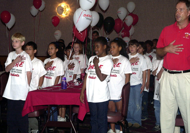 Children from Sterling Heights Elementary school recite the pledge of allegiance at the Drugs Abuse Resistance Education (DARE) graduation on Kadena Air Base (AB), Okinawa, Japan