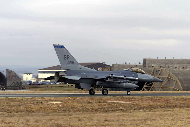 US Air Force (USAF) F-16CJ Fighting Falcon aircraft, assigned to the 23rd Fighter Squadron (FS), slows to a stop after engaging the barrier arresting system cable on the North Atlantic Treaty Organization (NATO) Parallel taxiway, during a certification test, being conducted by the 52nd Civil Engineer Squadron (CES), 52nd Fighter Wing (FW), at Spangdahlem Air Base (AB), Germany