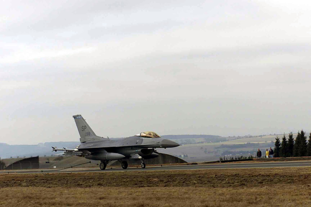US Air Force (USAF) F-16CJ Fighting Falcon aircraft, assigned to the 23rd Fighter Squadron (FS), engages the barrier arresting system cable on the North Atlantic Treaty Organization (NATO) Parallel taxiway, during a certification test, being conducted by the 52nd Civil Engineer Squadron (CES), 52nd Fighter Wing (FW), at Spangdahlem Air Base (AB), Germany