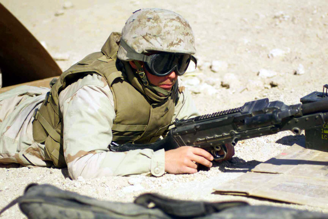 US Marine Corps (USMC) Lance Corporal (LCPL) Jered Kingery, part of Mike Battery 3/11, mans an FNMI 7.62 mm M240 Machine Gun on the perimeter of Camp Ripper, Kuwait, during Operation ENDURING FREEDOM