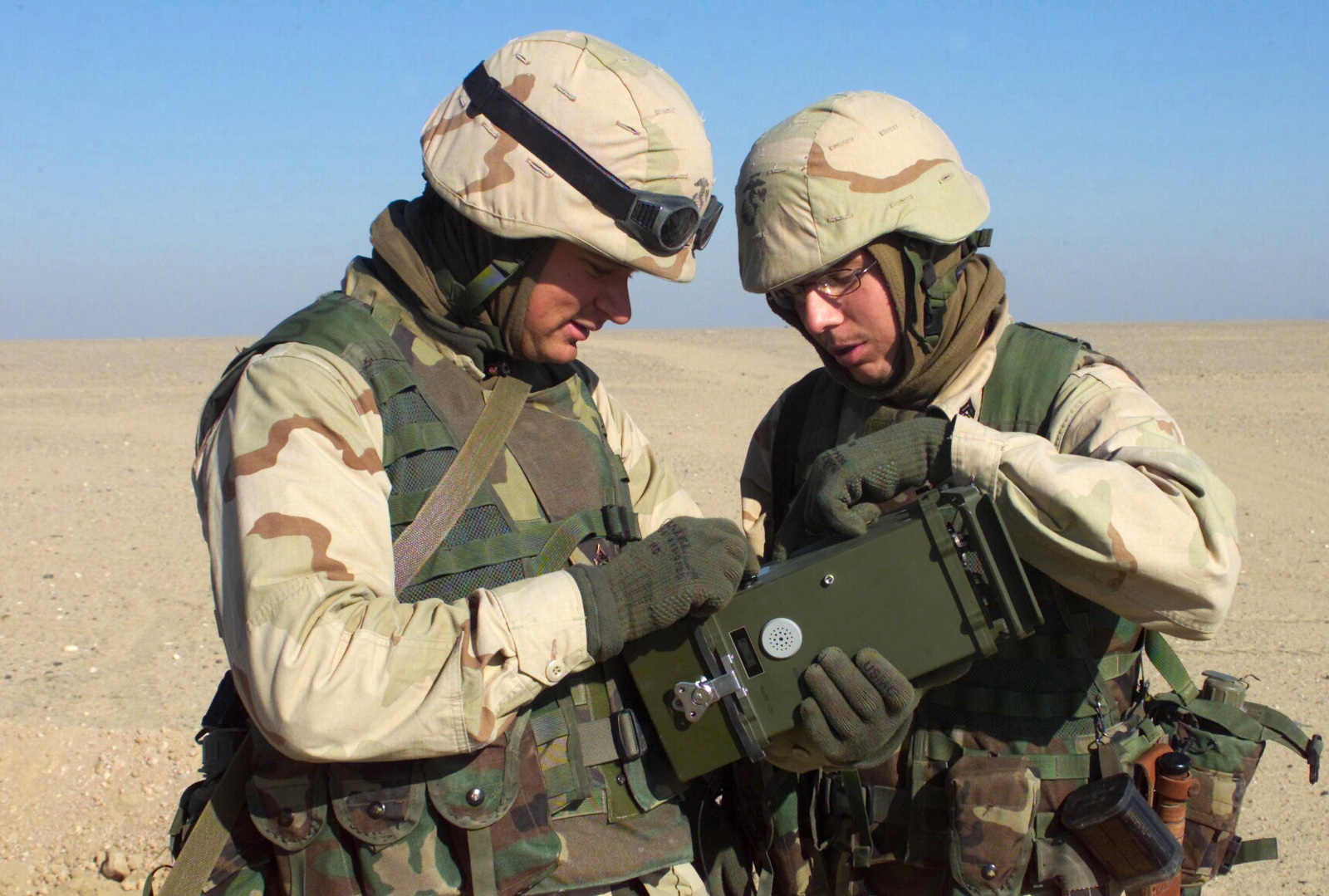 US Marine Corps (USMC) Corporal (CPL) Harry Klein (left) and CPL Shawn Cook, both assigned to 1ST Marine Division, examine an XM22 Automatic Chemical Agent Detection Alarm (ACADA) during an exercise conducted in Kuwait, during Operation ENDURING FREEDOM