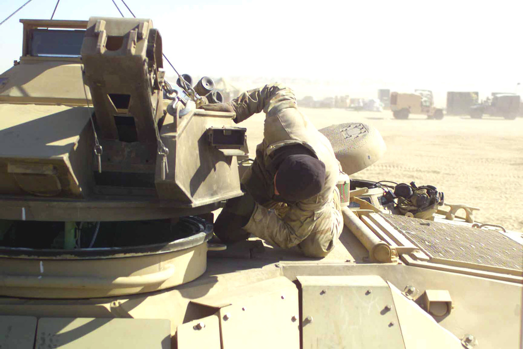 US Marine Corps (USMC) Corporal (CPL) Jon Swan, a Marine with Delta Company, 3rd Tracks, lowers the turret to an Amphibious Assault Vehicle (AAV) into position at Camp Coyote, Kuwait, during Operation ENDURING FREEDOM