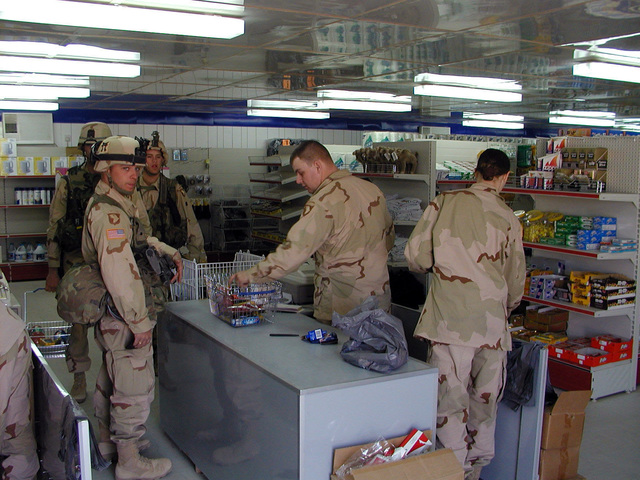 Members of the US Army (USA) 101st Airborne (ABN) Division, Ft Campbell, Kentucky (KY), purchase supplies in the base Army and Air Force Exchange Service (a.k.a. BX/PX (Base or Post Exchange)) during IRAQI FREEDOM