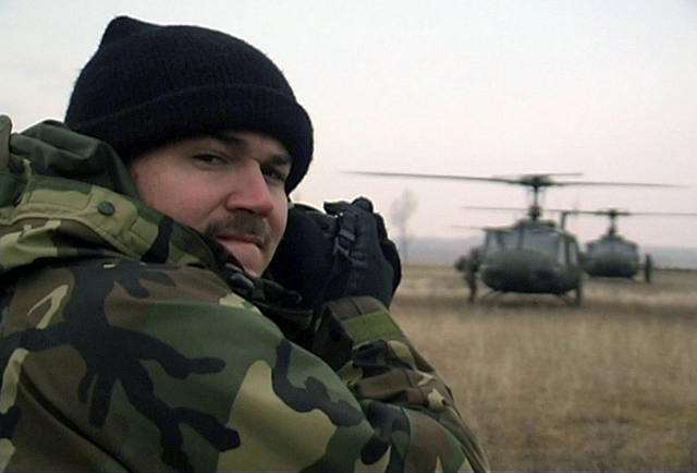 Part of a US Air Force (USAF) documentation team, STAFF Sergeant (SSGT) S.C. Felde, from the 886th Communications Squadron (CS), Sembach Annex, Germany documents the arrival of several UH-1 Iroquois helicopters, flying in support of the Georgia Train and Equip Program (GTEP)