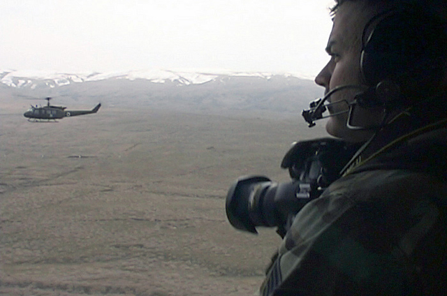 Part of a US Air Force (USAF) documentation team, STAFF Sergeant (SSGT) S.C. Felde, from the 886th Communications Squadron (CS), Sembach Annex, Germany documents the flight of several UH-1 Iroquois helicopters, flying in support of the Georgia Train and Equip Program (GTEP)