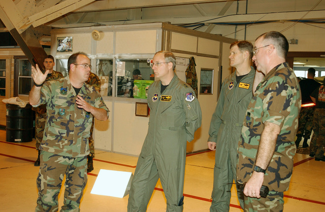 US Air Force (USAF) SENIOR MASTER Sergeant (SMSGT) Michael Bogaert, with the 325th Maintenance Squadron (MXS), Phase Flight CHIEF, explains the role of a phase dock to Major General (MGEN) James Sandstrom, 19th Air Force Commander, while Brigadier General (BGEN) Larry New, from the 325th Fighter Wing (FW) Commander and Colonel (COL) Jeffrey Snyder, the 325th Maintenance Group (MXG) Commander look on