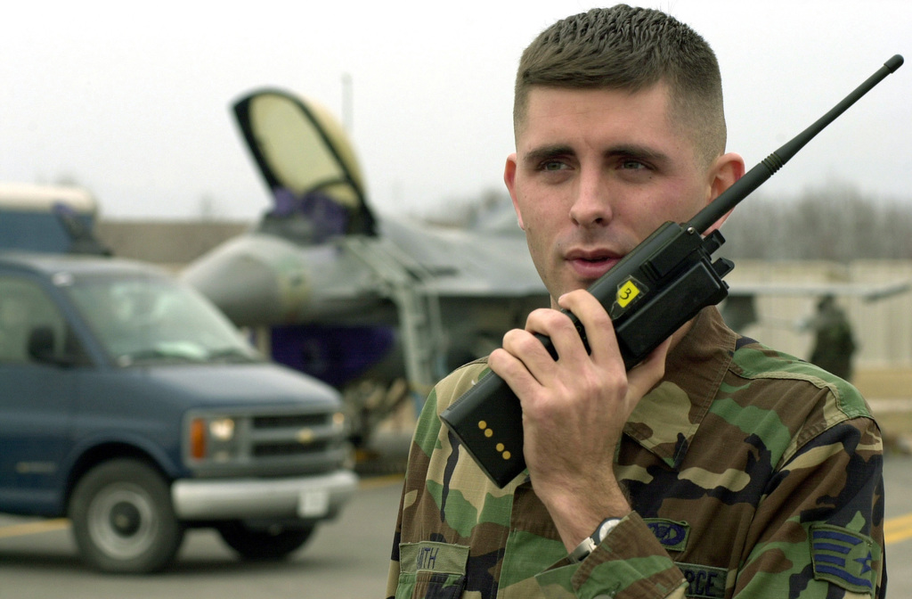 US Air Force (USAF) STAFF Sergeant (SSGT) Shawn Smith, with Airfield Management, 31st Operations Support Squadron (OSS), coordinates airfield sweeping operations for Foreign Object Debris (FOD), prior to an F-16 Fighting Falcon take-off