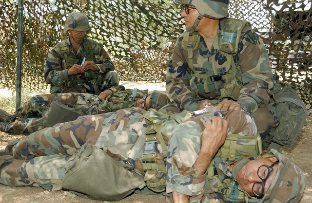 US Army (USA) Puerto Rico National Guard Soldiers, assigned to 130th Charlie Company, train on how to inject an antidote into a simulated contaminated victim, during the chemical, biological training portion of the Common Task Training (CTT), at the Camp Santiago Training Site (CSTS), located in Salinas, Puerto Rico (PR)