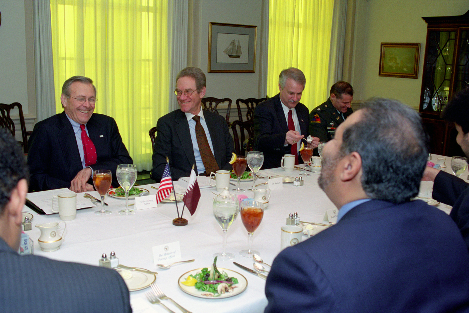 The Honorable Donald H. Rumsfeld (left), U.S. Secretary of Defense, laughs at a working lunch with (left to right) Peter Rodman, Assistant U.S. Secretary of Defense for International Security Affairs, Dr. William Luti, Deputy Assistant Secretary for Near Eastern and South Asian Affairs, U.S. Army LT. COL. Steve Soucek, the Country Director for Qatar and Foreign Minister Sheikh Hamad of Qatar (right front) at the Pentagon, where they are discussing important Middle East issues, March 7, 2003. (DoD photo by Robert D. Ward) (Released)