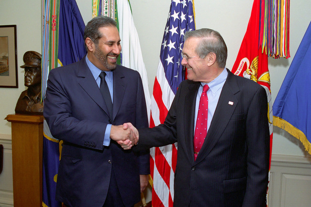 The Honorable Donald H. Rumsfeld (right), U.S. Secretary of Defense, poses for a handshake picture with Foreign Minister Sheikh Hamad of Qatar, at the Pentagon, where they will discuss important Middle East issues, March 7, 2003. (DoD photo by Robert D. Ward) (Released)