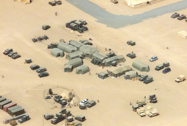 An aerial view of the 1ST Marine Division Main, Command Operation Center (COC) operated by US Marine Corps (USMC) personnel assigned to Headquarters Battalion, 1ST Marine Division, at Camp Matilda, Kuwait, during Operation ENDURING FREEDOM
