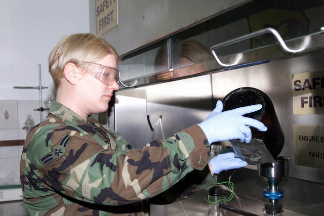 US Air Force (USAF) AIRMAN First Class (A1C) Jennifer Nelson, a Fuels Laboratory analysis member with the 52nd Logistics Readiness Squadron (LRS), at Spangdahlem Air Base (AB), Germany, performs a quality assurance test on a fuel sample