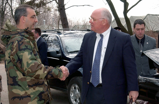 US Ambassador to Bulgaria, the honorable James W. Pardew, meets with US Air Force (USAF) Colonel (COL) James Muscatell, the Commander of Camp Sarafovo, in Burgas, Bulgaria. His visit represents the continued commitment of the United States to support the troops deployed-forward